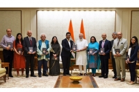 Manoj Ladwa & other dignitaries presenting the book to Prime Minister Narendra Modi