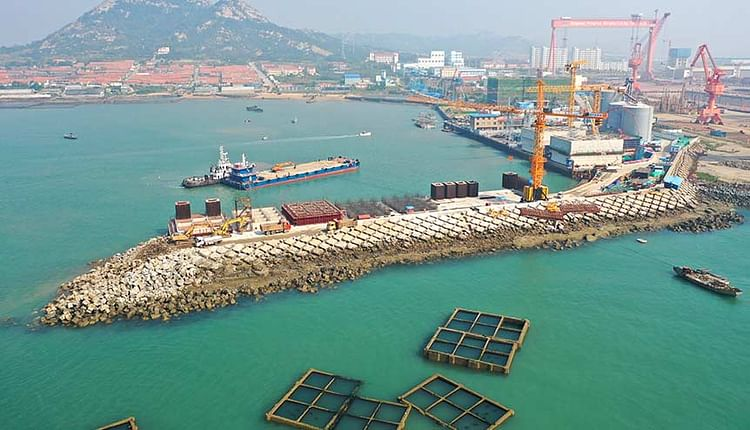 Aerial view of Qingdao Port undergoing expansion in Qingdao city, east China's Shandong province. China accounted for 22 per cent of all global exports.Courtesy: Reuters  The time for dithering over China is over 12 igb