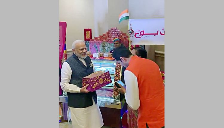 Indian prime minister Narendra Modi buys sweets from an Indian shop after the official launch of RuPay NPCI card in the UAE during an official visit there.Courtesy: ANI  Technology nationalism is here to stay 5