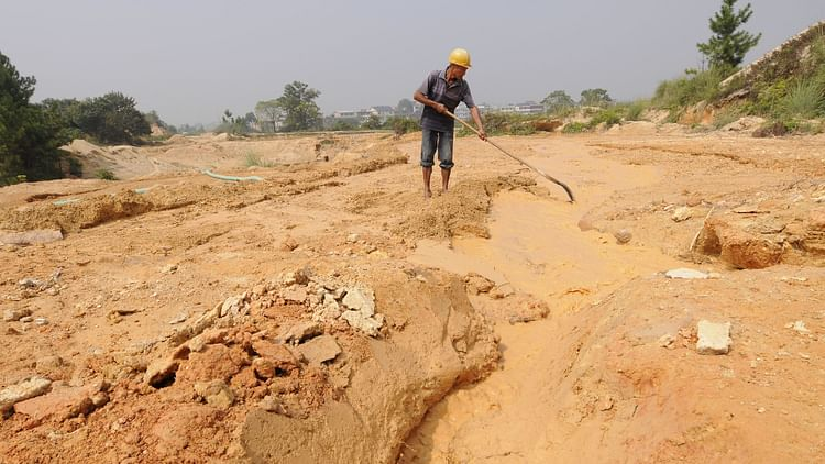 """A labourer works at the site of a rare earth metals mine at Nancheng county, Jiangxi province. China, which produces about 60 per cent of the world's rare earths, has been """"weaponising"""" this dominance to try and blackmail others into toeing its line.Courtesy: Getty Images  Quad cooperation on rare earths could decide winner of technological race GettyImages 539713250"""